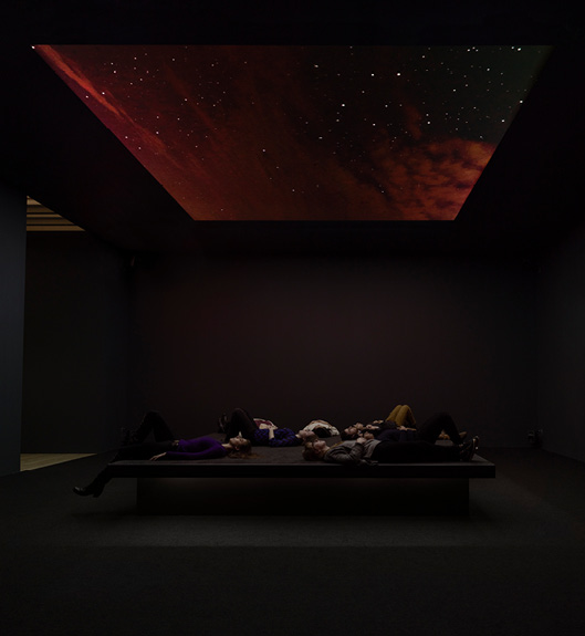 "Laura Poitras, ""Bed Down Location,"" 2016. Installation featuring time-lapse video projections of night skies in Yemen, Somalia, Pakistan, and Nevada. Photo: Amir Eshel"